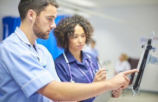 Man and woman working in acute care setting