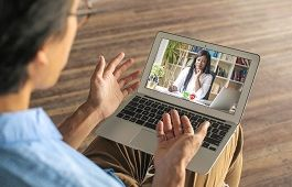 Person on video call with woman
