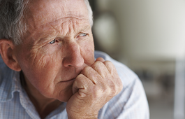 Older man looking thoughtful